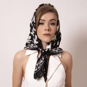 Style inspired by Grace Kelly, wrap ärtskül's Baby Pop Medium Square Scarf around your head and channel your inner film star. Our remixed houndstooth pattern features the baby icon. Create a little edge and surprise to this modern take on fifties sophistication.  Pair this unique scarf with a jumper for this chic look fit for a princess and creative it girl.