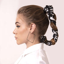 Load image into Gallery viewer, Rock your locks with artskul's chic black and white logo scarf. Elevate and transform a simple braided twist into a stylish hair statement.