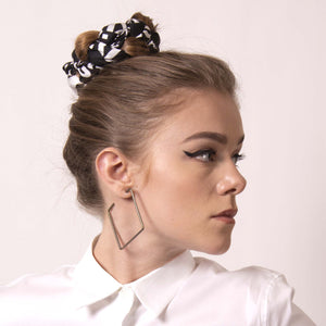 You can tell a lot about someone from the bun they choose to wear. artskul's chic black and white logo scarf can transform your throw-up-and-go hairstyle into a polished statement about what your bun says about you.