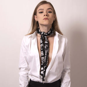 Transform our artskul square scarf into a long skinny scarf with a simple fold and roll. Our classic black and white logo scarf adds a sharp and finished statement to your style.