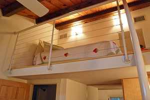 Stainless steel cable railings in loft