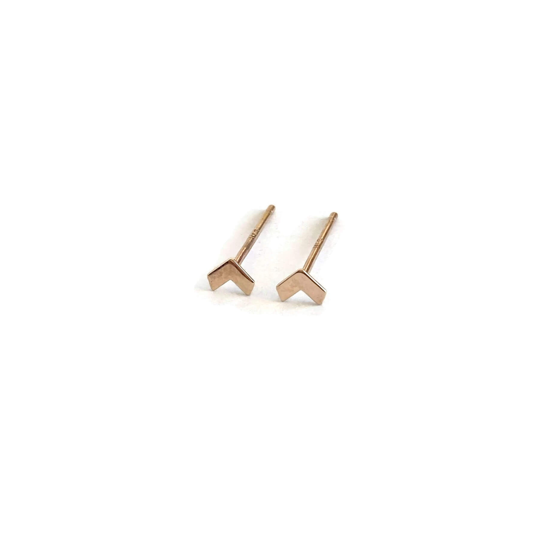 The tiny arrow stud earrings are made of solid 14k gold. The gold arrow earrings are for the earlobes or for cartilage pierced ears.