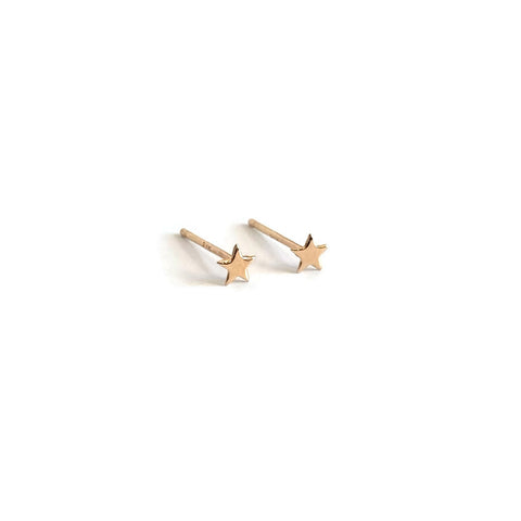 small 14k gold stud earrings feature tiny gold star earrings.