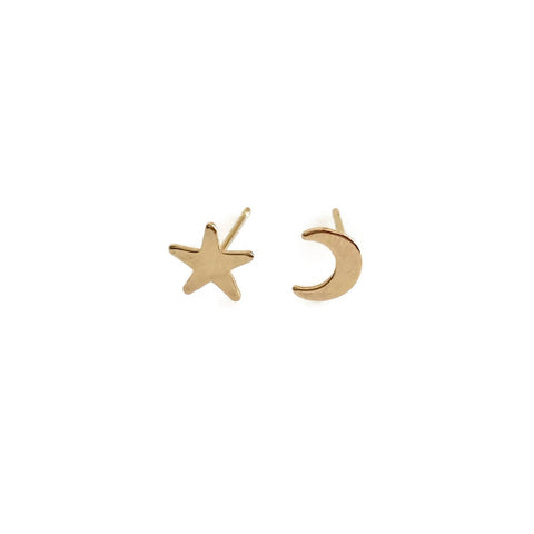 This mismatched moon and star stud earrings are made of solid 14k gold. The moon is a crescent moon shape mismatches with the single star stud.  The two make it a fun pair of gold stud earrings.