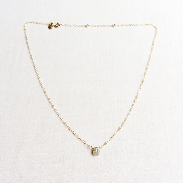 This uncut diamond necklace is simple and dainty. The rough cut diamond necklace is sourced ethically with care.