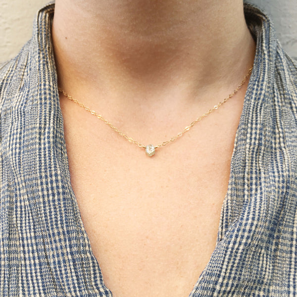 Rough diamond necklace is made of raw diamond and gold chain. It's handmade in our jewelry design studio in San Francisco.