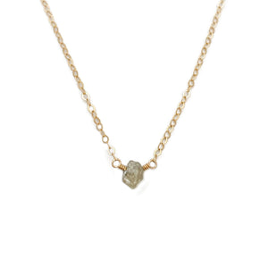 The raw diamond necklace is made of an uncut diamond and 14k gold chain.  This uncut diamond necklace can also be made in gold filled or sterling silver chain.