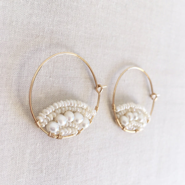 pearl hoop earrings are made of fresh water pearl