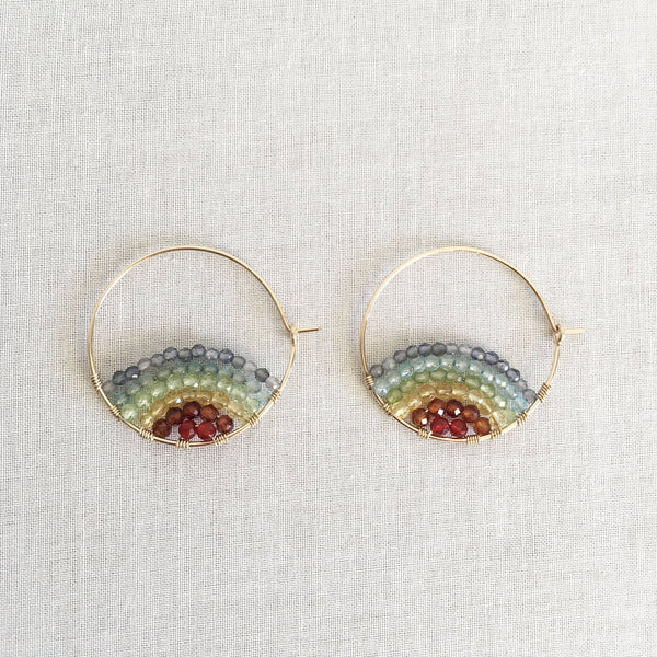These sunrise hoop earrings are made of different rainbow color gemstone crystals. They are super cute earrings and each pair is one of a kind.