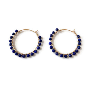 These Lapiz Lazuli hoop earrings are one of our favorite gemstones known for its deep blue color and calming energy.