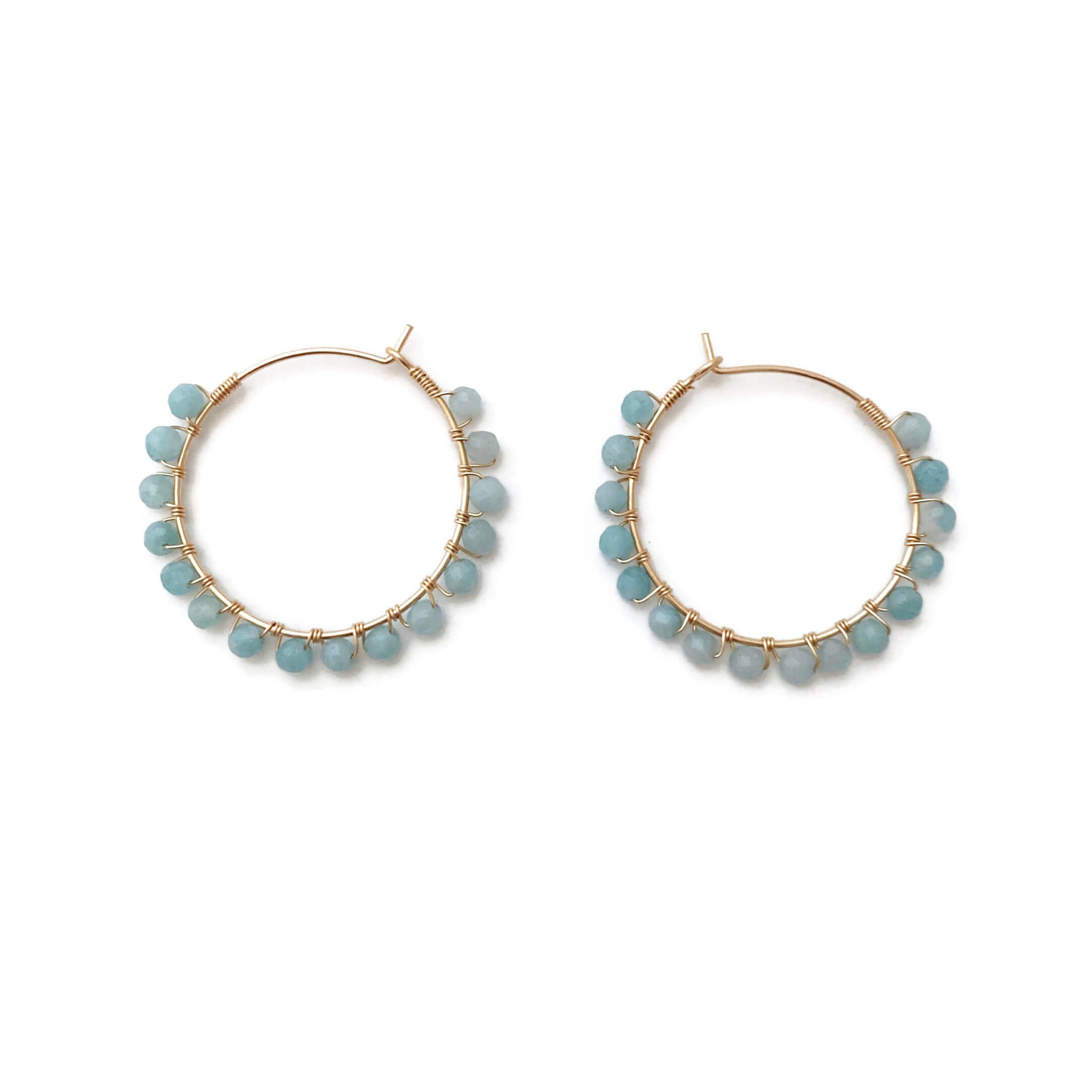 These are amazonite hoop earrings. The color is light blue.  Amazonite is a great gemstone for calming and anti anxiety.