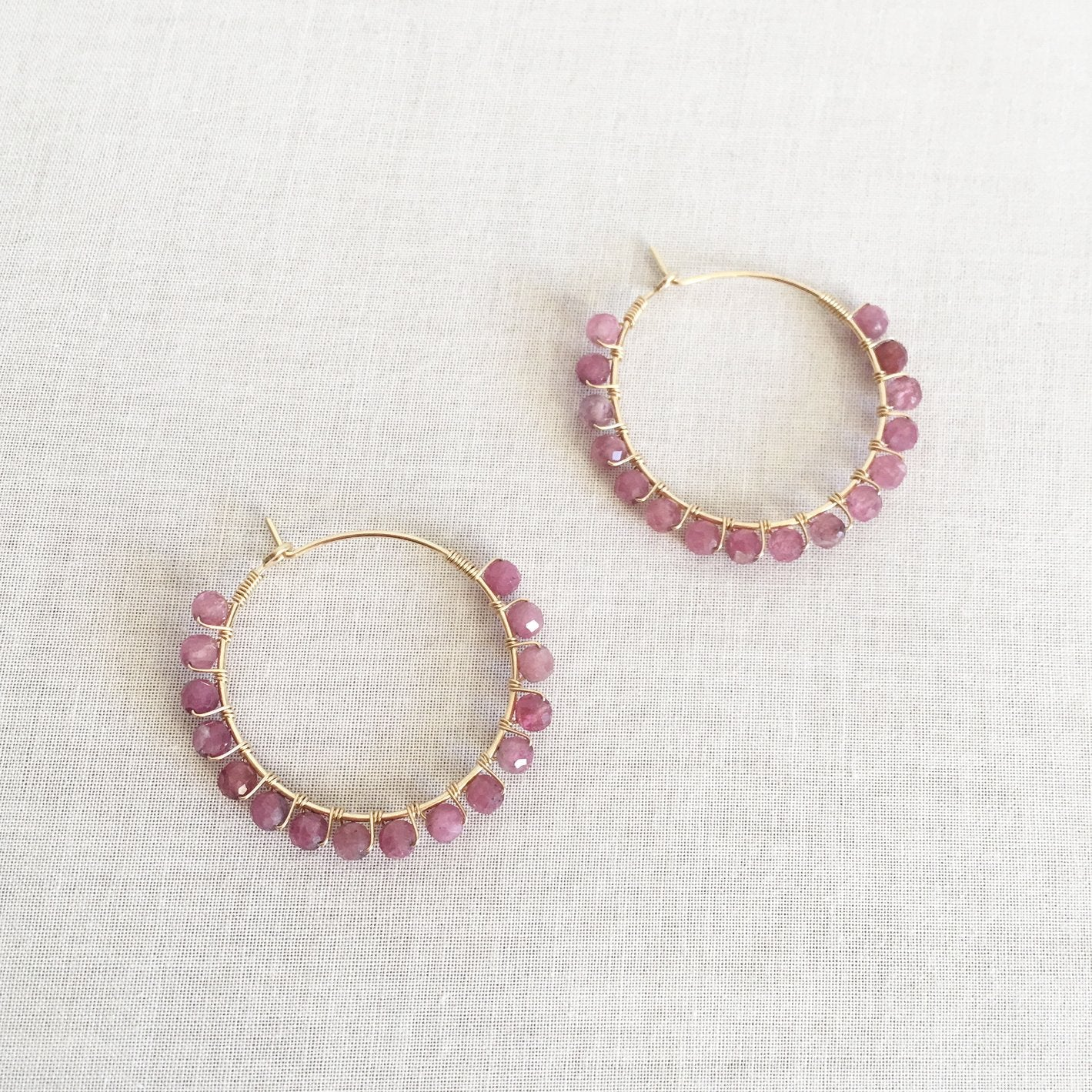Pink tourmaline hoop earrings are made of gold filled material