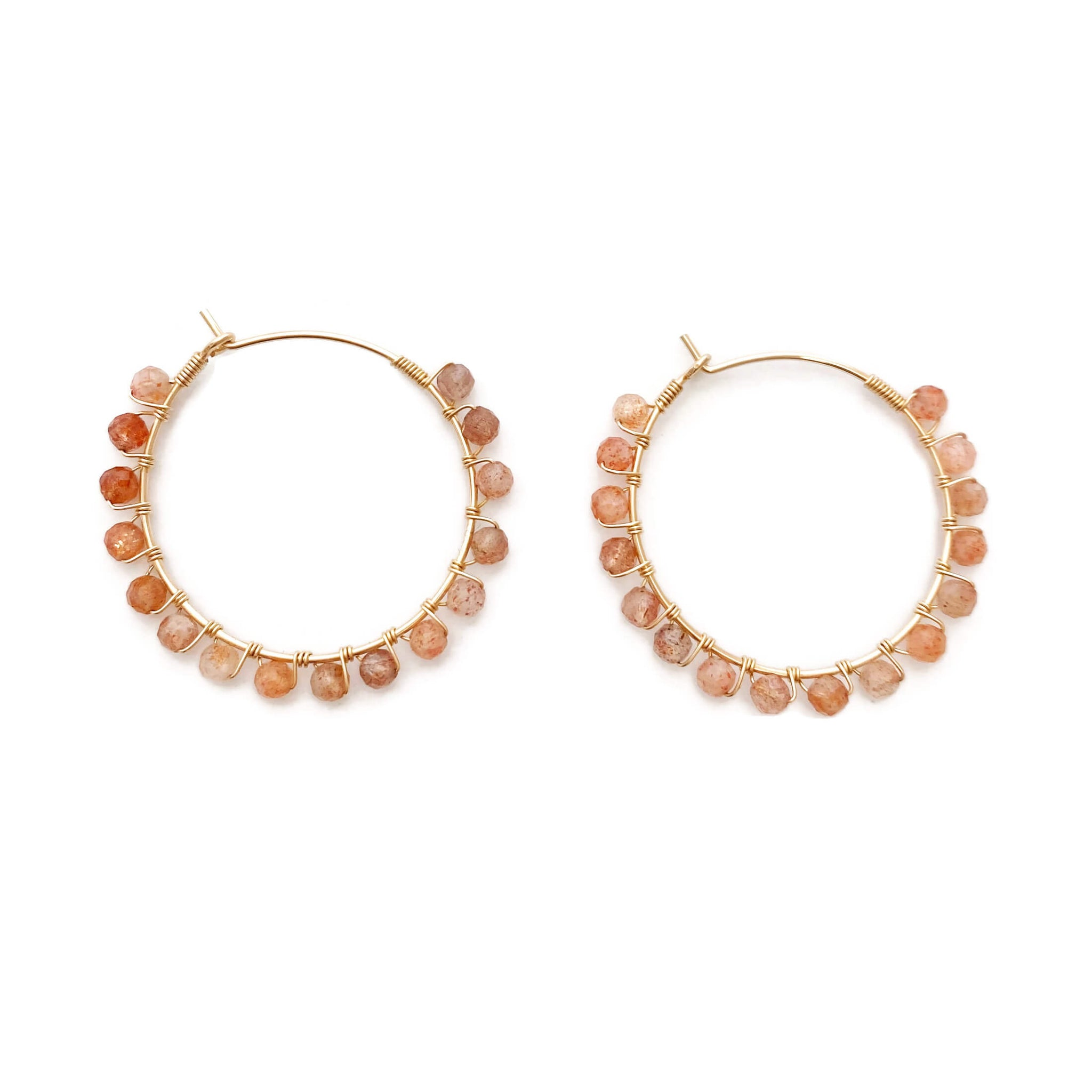 This Sunstone hoop earrings are versatile and playful. Sunstone is a leadership stone, it gives you strength and nurtures your leadership qualities.