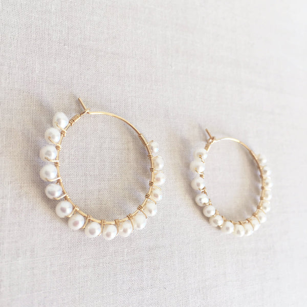 this is a pair of genuine pearl hoop earrings