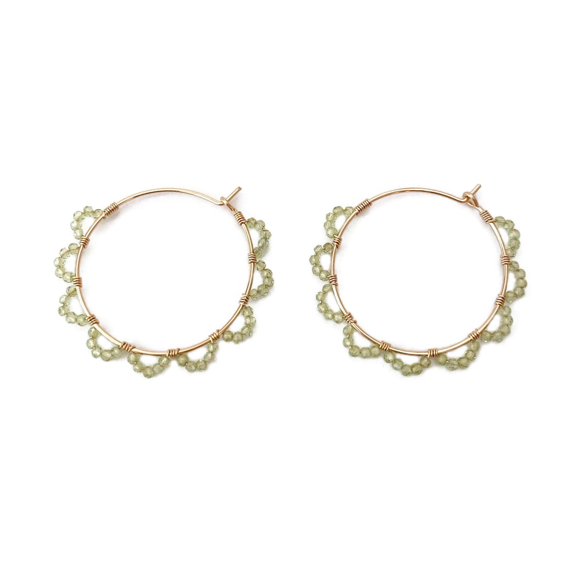 these peridot hoop earrings are elegant and they look like green petals.