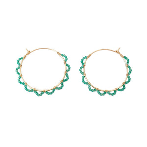 these green onyx hoop earrings look like petals around the hoop.  The deep green gives them luxurious look.