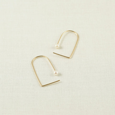 Minimal Pearl earrings are made of gold filled material.