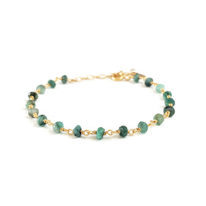 This dainty emerald bracelet is also a May Emerald birthstone bracelet.