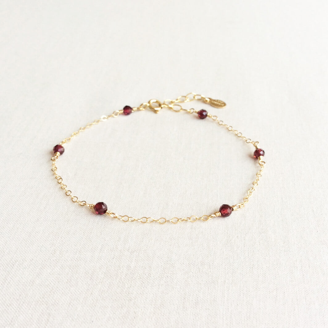 14k gold garnet bracelet with adjustable chain in 14k or gold filled