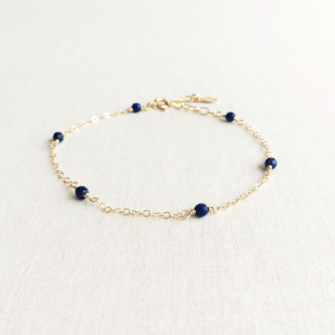 dainty lapis lazuli gold bracelet with adjustable chain in 14k or gold filled