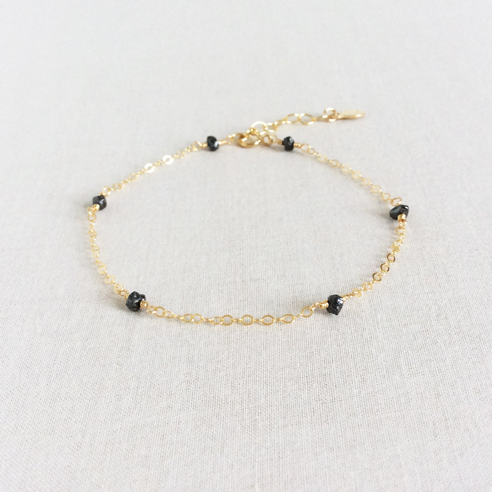 dainty black diamond gold bracelet with adjustable chain in 14k or gold filled