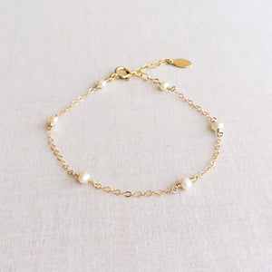 14k gold dainty pearl bracelet with adjustable chain in 14k or gold filled