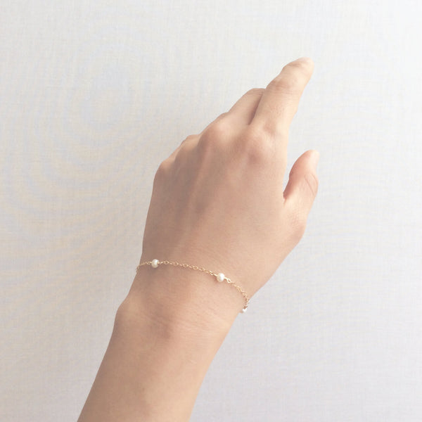 Gold fresh water pearl bracelet with adjustable chain in 14k or gold filled