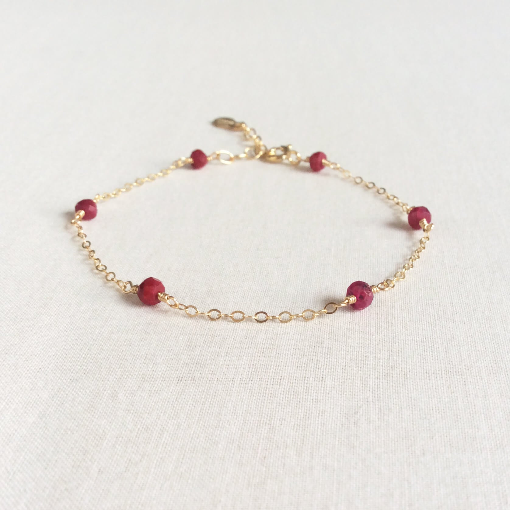 14k gold ruby bracelet with adjustable chain in 14k or gold filled