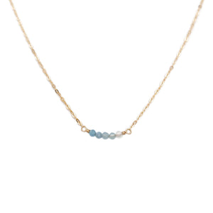 This ombre blue necklace is made of genuine shaded aquamarine beads and 14k gold chain.  It can be made in gold filled chain or sterling silver chain with extender.