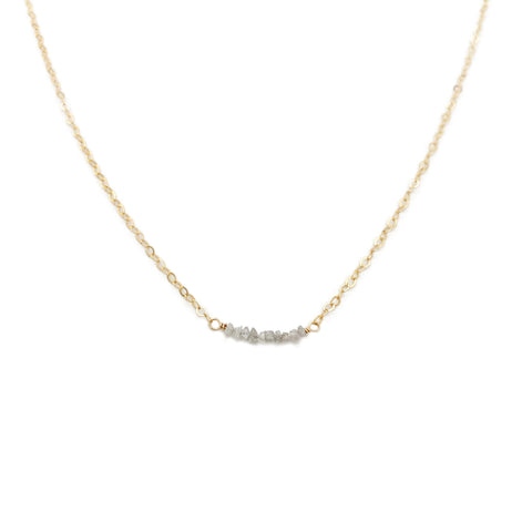 The dainty diamond bead necklace is made with hand selected raw diamonds and 14k gold chain.  We can also custom make it in sterling silver or gold filled chain.