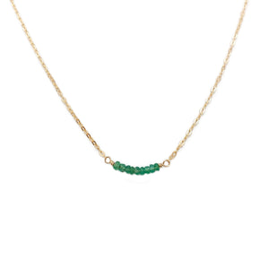 This dainty emerald bead necklace is made of 14k solid gold chain and genuine Colombian emerald beads.