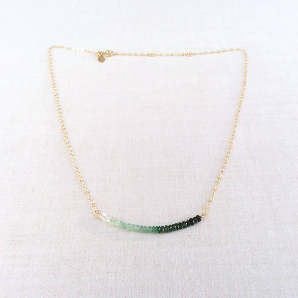This emerald bead necklace is made of real natural emerald beads and gold filled chain.  We can make it in solid 14k gold or sterling silver. This ombre emerald necklace is adjustable and can be worn as a choker.