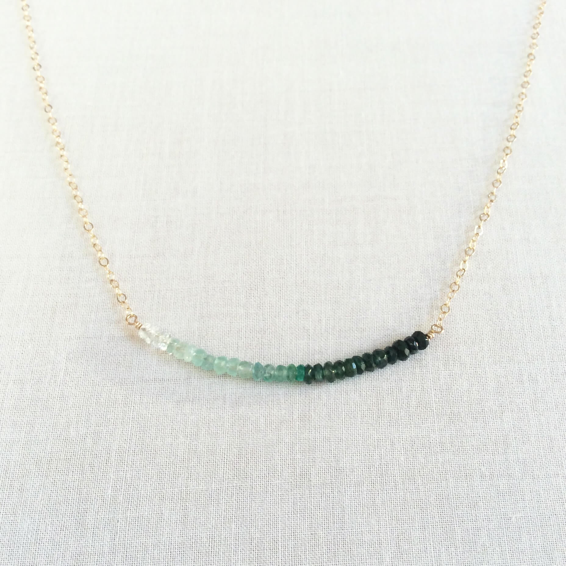 This ombre emerald necklace is made of real emerald beads and 14k gold chain. We can also make it in sterling silver or 14k gold filled chain.  The emerald beads are natural and real.