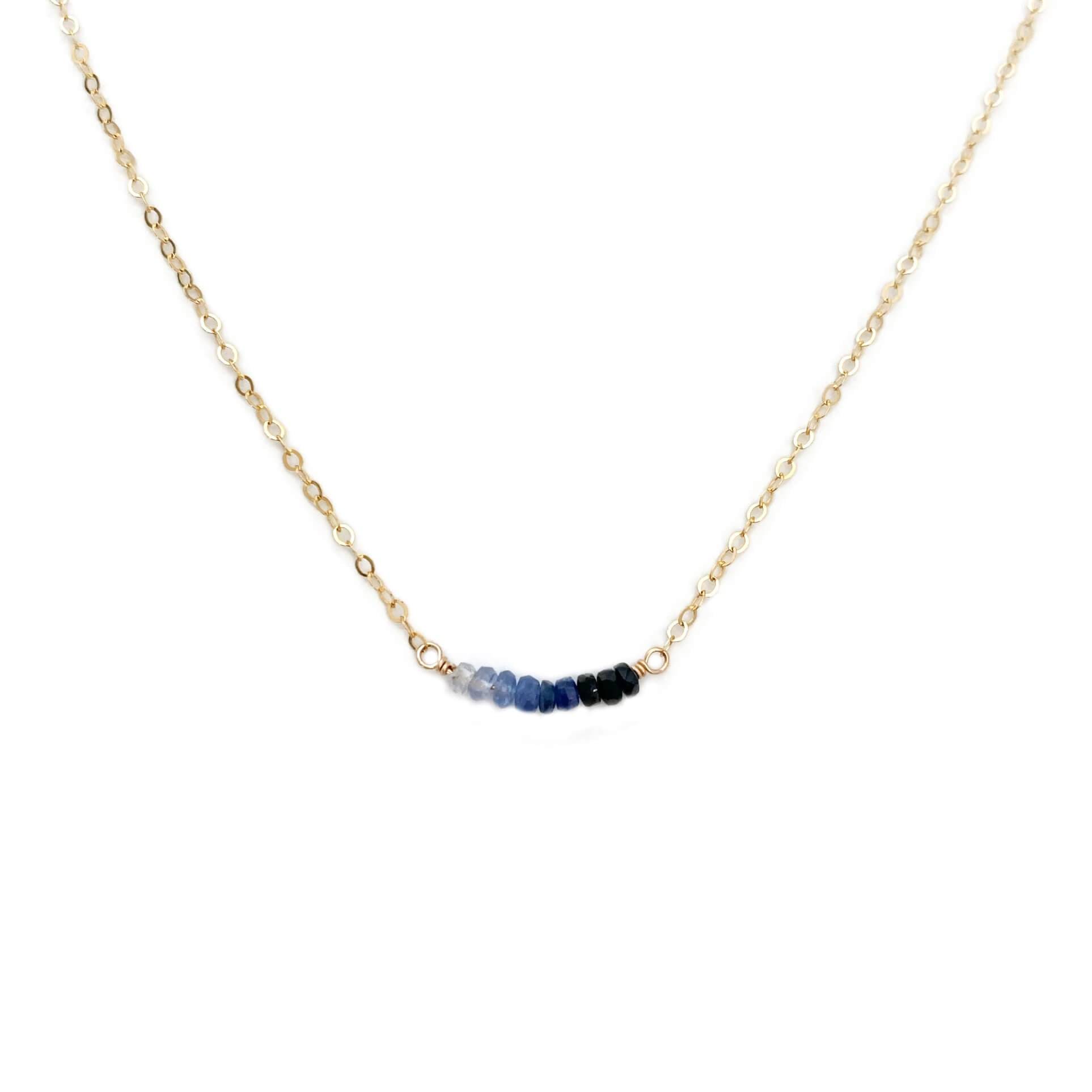 This dainty sapphire necklace is made of genuine sapphire beads and 14k gold chain.  We can make it in sterling silver or gold filled chain with extender.