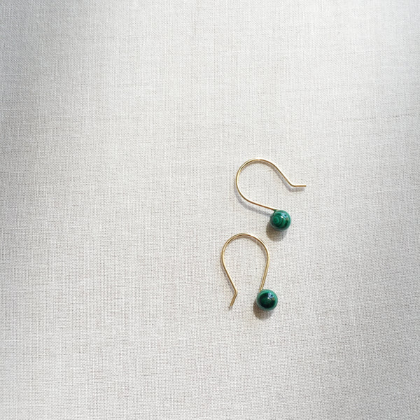 There are simple and dainty earrings made of Malachite gemstone beads.