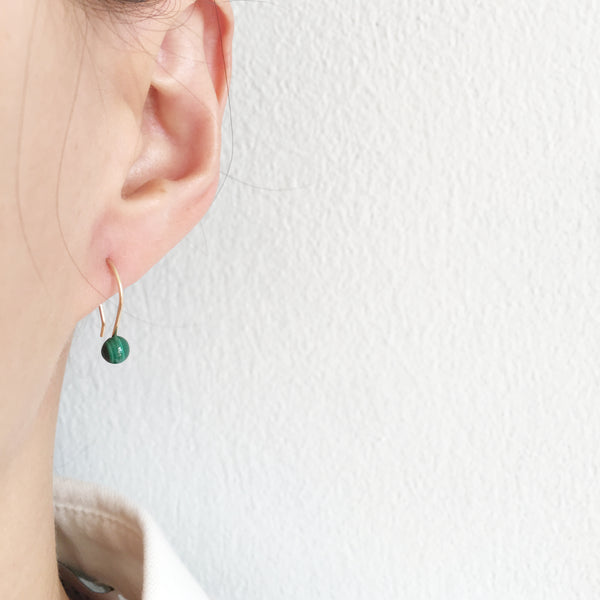 This dainty drop earings are made of Malachite and gold filled wire.