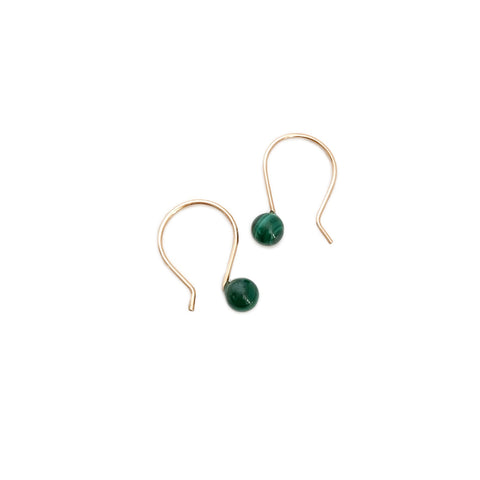 Malachite earrings are made in San Francisco.