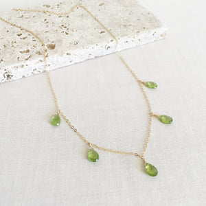 This peridot necklace is made of 5 real peridot gemstones and 14k gold chain.