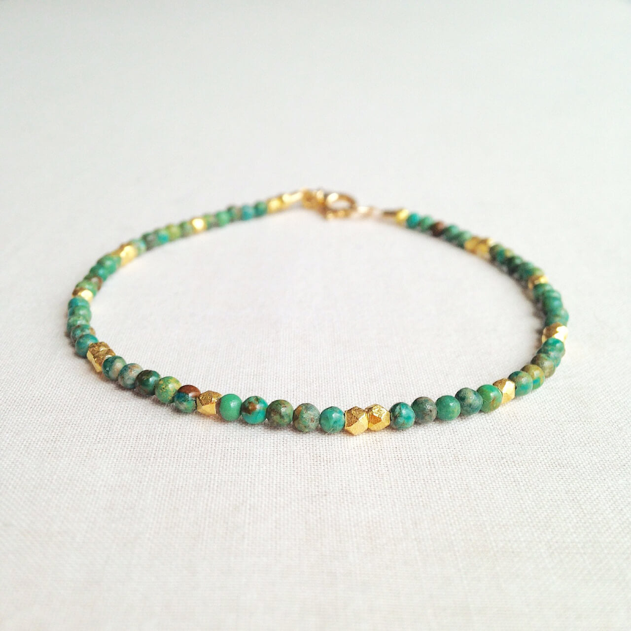 This beaded turquoise bracelet exudes a timeless look that would be fit for a queen.  The dainty turquoise bracelet is made of hand-selected blue turquoise beads and 24k gold plated beads.