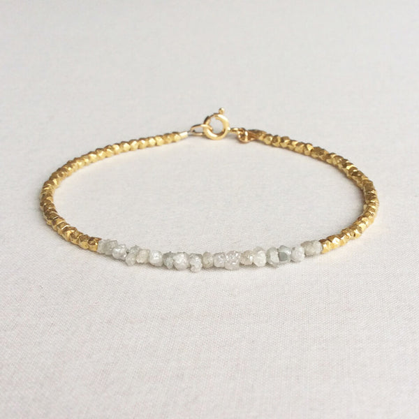 This raw diamond bracelet is made of genuine rough diamonds and 24k gold vermeil beads. They are 7 inches long and will fit a standard size wrist.