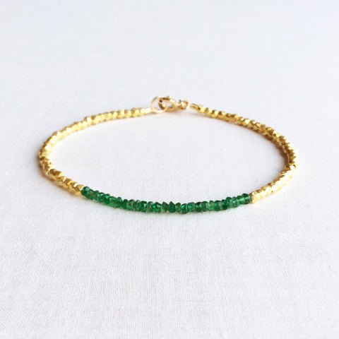 this beaded emerald bracelet exudes a timeless look that would be fit for a queen.  The dainty emerald bracelet is made of hand-selected green emeralds and 24k gold plated beads.