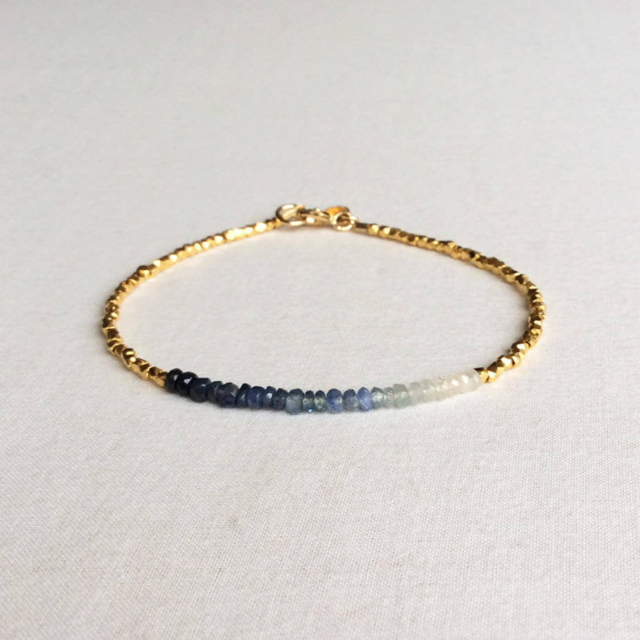 this ombre sapphire bracelet exudes a timeless look.  The bracelet is made with hand-selected sapphires that have different shades of blue – from nearly white to deep navy blue.