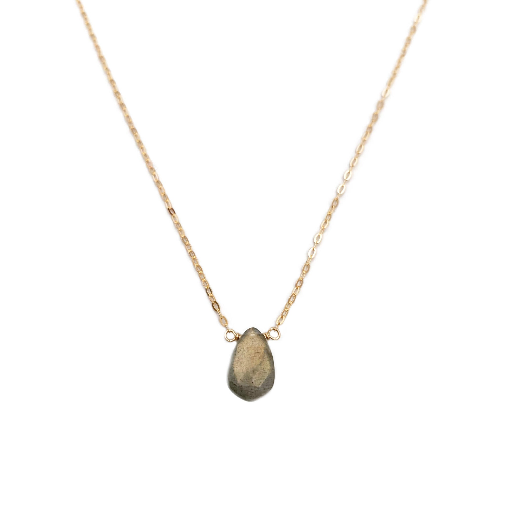 This labradorite healing necklace is made with a labradorite gemstone, a stone known for its energy and healing powers.