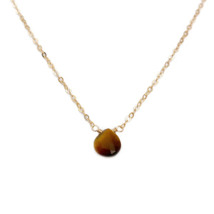 Dainty Tiger Eye necklace is simple and dainty.