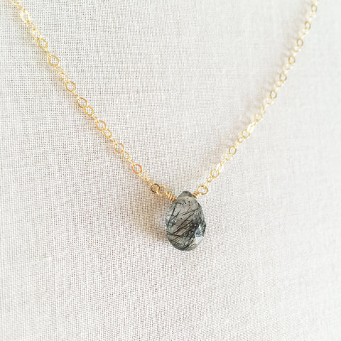 this black rutilated quartz necklace is made with a single gemstone called black rutilated quartz.  This healing quartz necklace has unique black lines through it caused by naturally occurring minerals inside the quartz stone.