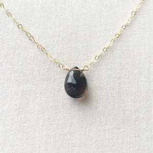 This smoky quartz gold necklace features a single grey gemstone attached to a 14k gold, gold fill or sterling silver chain.