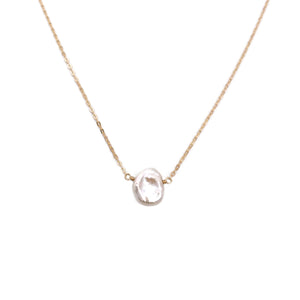 This real pearl necklace is made with a single genuine freshwater keshi pearl with adjustable chain.
