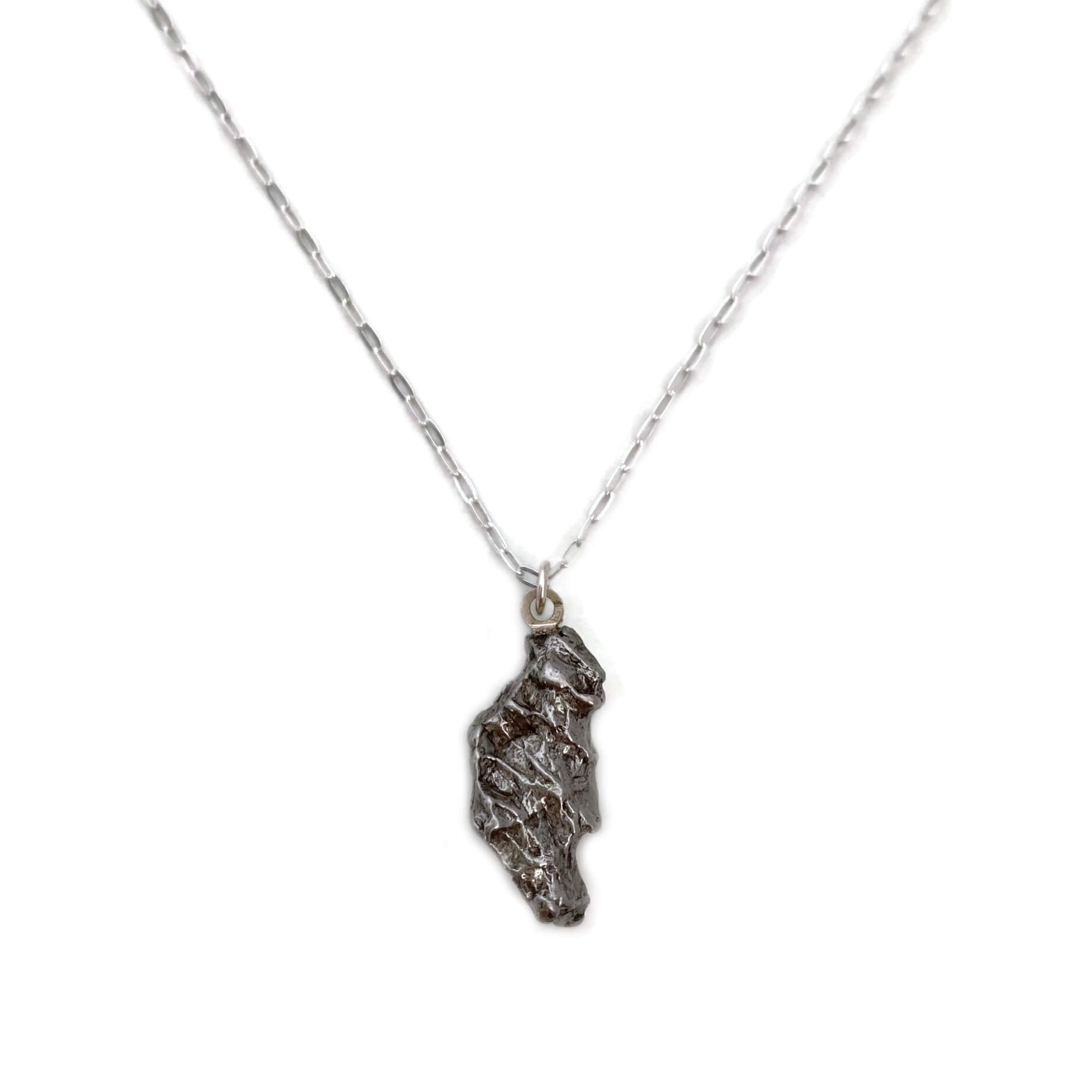 This meteorite necklace is made from a genuine piece of meteorite that crashed to earth near a place called Campo del Cielo in Argentina.  Studies have shown that the meteorite fell to earth around 4,500 years ago in South America.