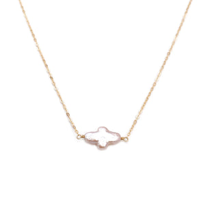 The sideway cross necklace is simple yet elegant, made using hand selected fresh water pearl.