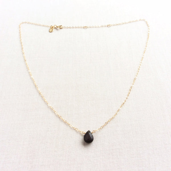 This simple but sophisticated dainty obsidian necklace is made with a single black obsidian gemstone.